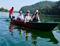 Tourists enjoy boating in Phewa Lake