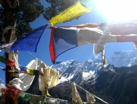 Prayer flag and Ganesh Himal view from Milarepa Cave