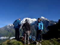 Trekkers enjoy the view of Annapurna South and Hiuchuli