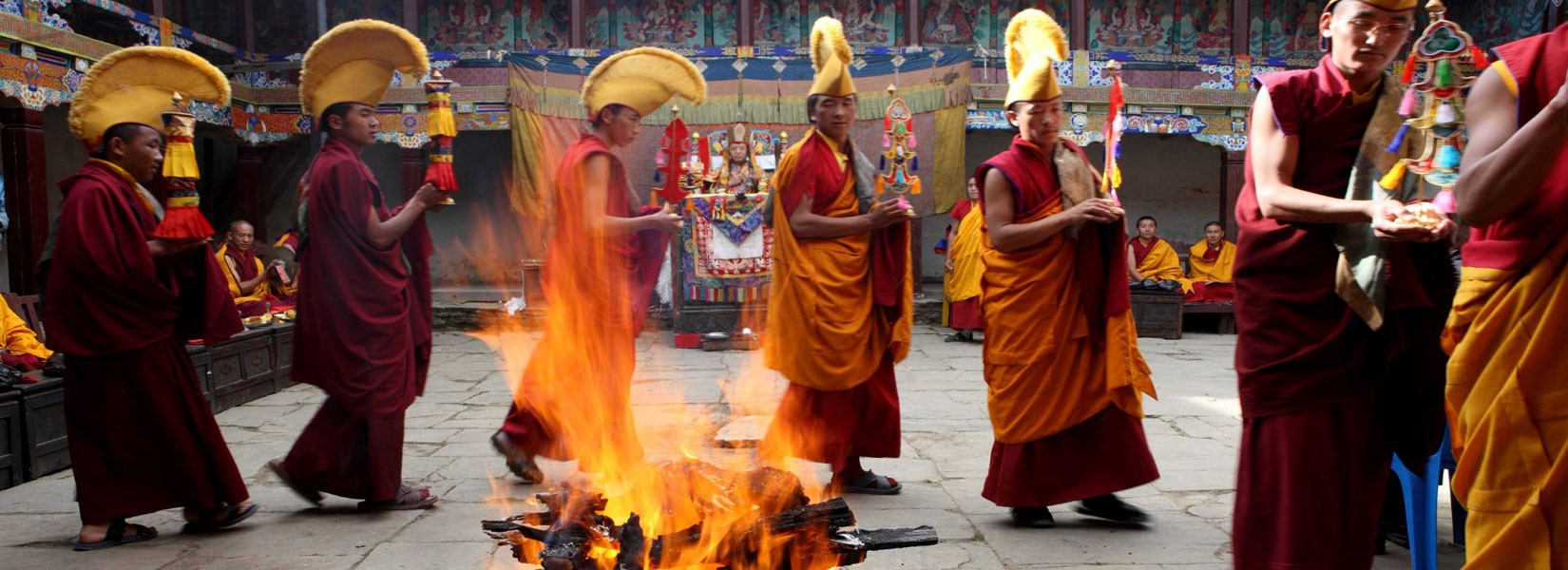 Monks performing fire puja during Mani Rimdu at Tengboche
