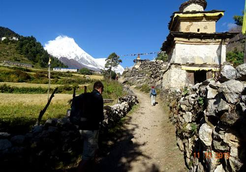 Buddhist Prayer wall and Mount Manaslu in the background